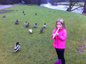 Playing a recorder at Bolton's Abbey